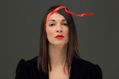 Girl with a red strip Royalty Free Stock Image
