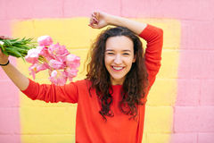Beautiful girl in red sweater on colorful yellow and pink background. Stock Images