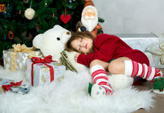 Beautiful girl in red sweater waiting Christmas and New year cel Royalty Free Stock Photography