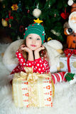 Beautiful girl in red sweater waiting Christmas and New year cel Stock Photography