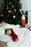 Beautiful girl in red sweater waiting Christmas and New year cel Stock Images