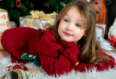 Beautiful girl in red sweater waiting Christmas and New year cel Royalty Free Stock Photo