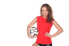 Beautiful girl in red t-shirt with football Royalty Free Stock Image