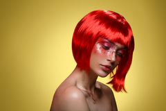 Beautiful girl in red wig Stock Photo