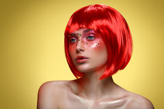 Beautiful girl in red wig Royalty Free Stock Images