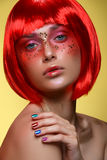 Beautiful girl in red wig Royalty Free Stock Photo