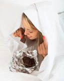 Beautiful girl relaxation and eating chocolate Royalty Free Stock Image