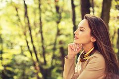 Beautiful girl relaxes and rest in autumn park. stock photos