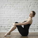 Beautiful girl relaxing after ballet training. Loft interior Royalty Free Stock Photos