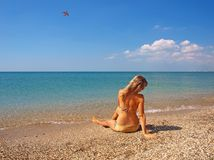 Beautiful girl relaxing on a beach Royalty Free Stock Photos