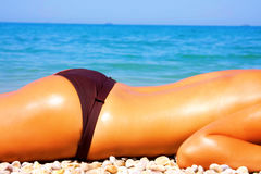 Beautiful Girl Relaxing on the Beach Royalty Free Stock Images