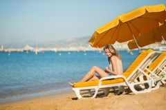 Beautiful girl relaxing on a beach chair Royalty Free Stock Image