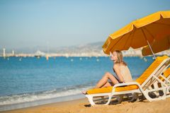 Beautiful girl relaxing on a beach chair Stock Photography