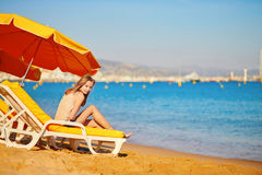 Beautiful girl relaxing on a beach chair Stock Photo