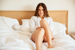 Beautiful girl relaxing in bed Stock Photography
