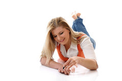 Beautiful girl relaxing on the floor Royalty Free Stock Images