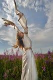 Beautiful girl relaxing among flowers Royalty Free Stock Image