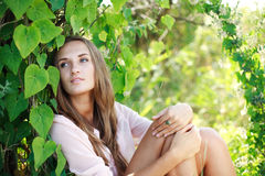 Beautiful girl relaxing in garden Stock Photography