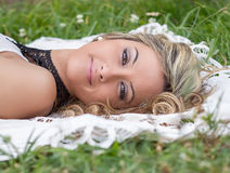 Beautiful girl relaxing on the grass royalty free stock image