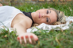 Beautiful girl relaxing on the grass royalty free stock photos