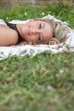 Beautiful girl relaxing on the grass Royalty Free Stock Photo