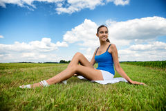 Beautiful girl relaxing in a green field Stock Photo