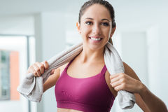 Beautiful girl relaxing at the gym Stock Photos
