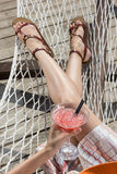 Beautiful girl relaxing on a hammock with a coctail Royalty Free Stock Images