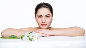 Beautiful girl is relaxing with lilies Royalty Free Stock Photos