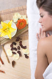 Beautiful girl relaxing on massage table Royalty Free Stock Image