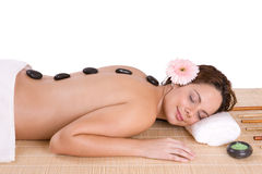 Beautiful girl relaxing on massage table Stock Photos