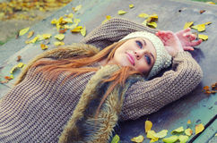 Beautiful girl relaxing in the nature on colorful autumn day Stock Photo