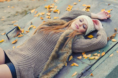 Beautiful girl relaxing in the nature on colorful autumn day Royalty Free Stock Image