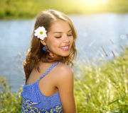 Beautiful girl relaxing outdoors. Countryside Royalty Free Stock Photos