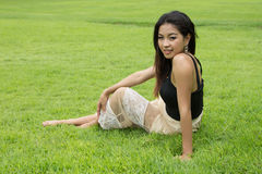 Beautiful girl relaxing in the park Stock Photo