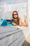 Beautiful girl Relaxing and reading  on the beach Stock Images