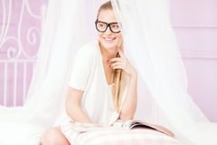 Beautiful girl relaxing, reading. Stock Images