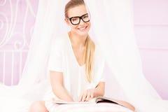 Beautiful girl relaxing, reading. Stock Photography