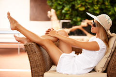 Beautiful girl relaxing on a resort Royalty Free Stock Photo