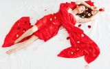 Beautiful girl is relaxing in rose petals Royalty Free Stock Images