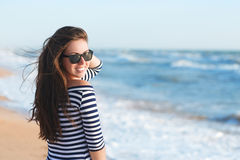 Beautiful girl relaxing and smiling outdoor at summer beach Stock Photos