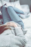 Beautiful girl is relaxing on the sofa, cozy concept Royalty Free Stock Image