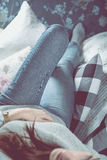 Beautiful girl is relaxing on the sofa, cozy concept Royalty Free Stock Images