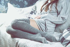 Beautiful girl is relaxing on the sofa, cozy concept Stock Photography