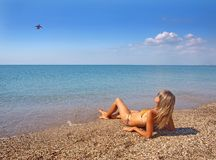 Beautiful girl relaxing on a summer beach Royalty Free Stock Image