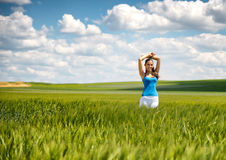 Beautiful girl relaxing in a summer wheat field Royalty Free Stock Photos