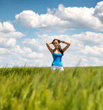 Beautiful girl relaxing in a summer wheat field Royalty Free Stock Photo