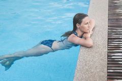 Beautiful girl resting in swiming pool Stock Images