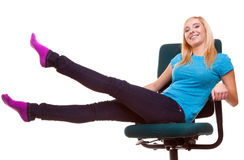 Beautiful girl relaxing on wheel chair Royalty Free Stock Photo