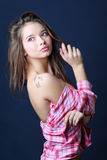 Beautiful girl in removed in half shirt looks away stock images